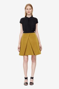 This pleated A-line skirt is made from a cotton-mix with a soft textured finish. Cut for a voluminous fit and designed to sit on the waist, it has a hidden back zip, in-seam pockets and an elasticated waistband.
