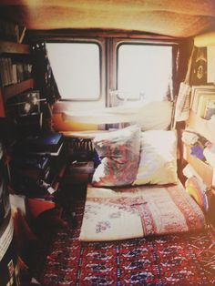 Bohemian campervan. Love the rugs.