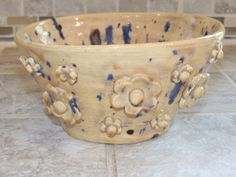 Hand thrown one of a kind bowl. Gold color with speckles, raised flowers added for a specil touch. food safe, hand wash by GabiLuBoutique on Etsy