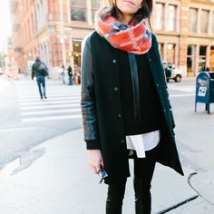noticed: leather with more leather. stylist julia gall is wearing a black madewell leather-sleeve varsity coat, leather-inset sweatshirt, skinny skinny zip jeans: leather-patch edition and a red and blue plaid infinity snowfall circle scarf.