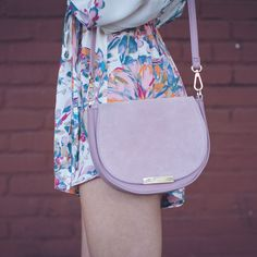 Pink is perfect for the spring. Wedding season is coming up. Pair your floral romper with a Suede Foldover Crossbody.