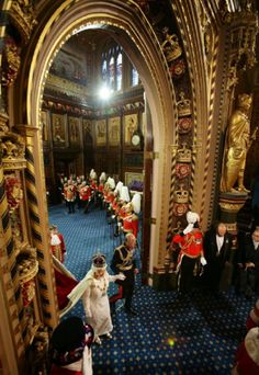 Queen Elizabeth II and the Prince Philip, Duke of Edinburgh proceed through the Royal Gallery.