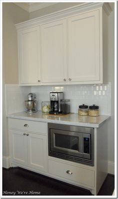 cream cabinets and countertops. Cabinet Paint: Devine White by Sherwin Williams- flat paint Microwave Cabinet, Kitchen Remodel, Cabinet Decor, Kitchen Cabinets Decor, Kitchen Dining Room, Kitchen Redo, Home Kitchens, Kitchen Renovation, Kitchen Design