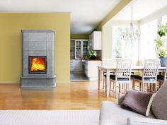The handsome AKKO soapstone masonry heater introduces a freshly updated old-world atmosphere to your home. The protruding decorative trim and rounded corners at the top and at the base lend their own appearance to the fireplace. Decor, Decorative Trim, Elegant, Home, Soapstone, Round Corner, Fireplace, Contemporary Rug