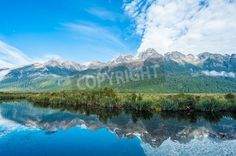 Mirror Lakes are a famous natural landmark omn the Milford Road in the Fiordland…