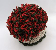 This basket is handmade and topped with an extra large red and green pom pom