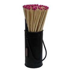 Decorative black metal steel match holder in the shape of a coal hod. Supplied with functional long matches which can be lit on the side of the holder. Lovely unusual gift.
