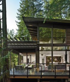 The qualities that made Johnny Bellas's property on British Columbia's Gambier Island attractive—a steep slope draped with trees overlook...#architecture