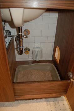 hidden cat litter box inside bathroom vanity includes cat door