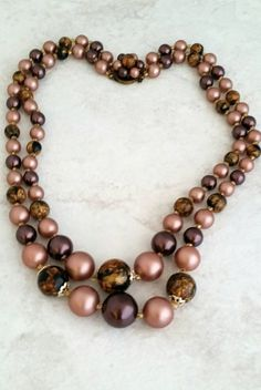 Check out this item in my Etsy shop https://www.etsy.com/listing/520567491/vintage-brown-mauve-lucite-bead-double