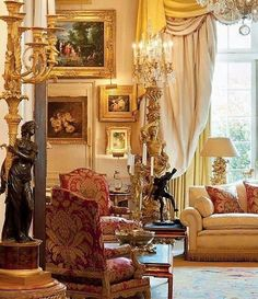 Sitting room with a beautiful torchere and candelabra.
