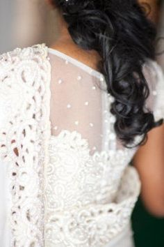 Sophisticated curtained back white saree blouse design. White buttoned back blouse design.