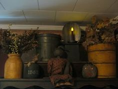 primitive display on cupboard...Maybe I'll do something like this after Christmas is gone above mine...
