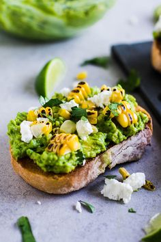 Grilled Corn Avocado Toast with Cilantro and Goat Cheese - Creamy mashed avocado on toast with fresh grilled sweet corn, goat cheese, cilantro, and a drizzle of lime juice. Vegetarian.