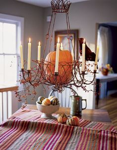 pumpkin chandelier = disaster waiting to happen. Thankful its not my house, nor where i will at for Thanksgiving.   #diamondcandles #harvestcontest2012