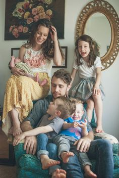 Perfect family portrait. You can see each individual personality—no lifeless posing here. (Go here: http://brittneysrabbithole.blogspot.com/2014/05/our-family-by-anastasia-serena.html for more of artist Anastasia Serena's shots of this beautiful family.).