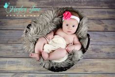 Here is a beautiful 2 month old baby girl from a recent session.   Baby pictures, baby girl, basket prop, faux fur newborn prop, 2 month picture, baby photo ideas, Calgary baby