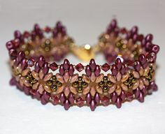 Original Starfire Design by Amy Johnson. Superduos in Burgundy and Peach tones…