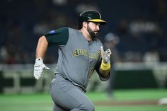 TOKYO, JAPAN - MARCH 10: Catcher Allan de San Miguel #11 of Australia runs after hitting a double in the top of the second inning during the World Baseball Classic Pool B Game Five between Australia and Cuba at the Tokyo Dome on March 10, 2017 in Tokyo, Japan. (Photo by Matt Roberts/Getty Images)