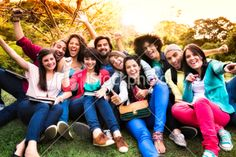 Multi-ethnic group of young students sharing at university campus Royalty Free Stock Photo