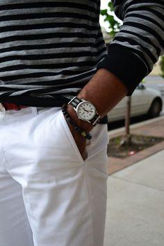 Gray & black stripe shirt, and white pants