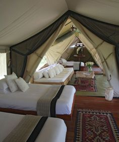 Glamping...multi-room tent with exquisite furnishings!  Yep....this would do!
