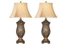 Katarina's acanthus leaf motif and urn-shaped base are read rich and sophisticated. Pale gold bell shade and antiqued tone add a bit of glitz and glamour. Both elegant and opulent, Katarina table lamp set is undeniably classy and classical.
