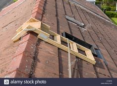 A home made roof step ladder by a skylight window, with safety rope. House Ladder, Roof Ladder, Diy Ladder, Roofing Tools, Diy Roofing, Copper Roof, Metal Roof, Safety Rope, Skylight Window
