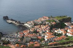 """Madeira- a year-round destination - EXAMINER.COM   unchal is located on the island of Madeira. It is the 6th largest city in Portugal and the capital of Madeira. It is approximately 360 miles directly west of Morocco, Africa in the Atlantic Ocean.. Centuries ago, Portuguese settlers were attracted to the mild Mediterranean climate and were overwhelmed by the wild fennel that permeated the terrain. Hence, """"funcho,"""" Portuguese for fennel became the source for the city's name"""