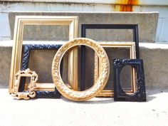 This listing is for a set 7 picture frames. They are made of wood, resin, metal and painted in black and metallic gold and lightly distressed.This