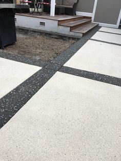 Concrete with a textured concrete overlay. Borders in exposed aggregate concrete to contrast and add visual punch! Concrete Backyard, Concrete Patio Designs, Concrete Overlay, Concrete Driveways, Stamped Concrete, Backyard Patio, Kid Friendly Backyard, Exposed Aggregate Concrete, Weatherboard House