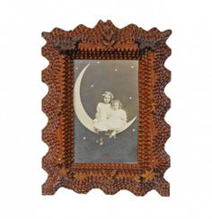 Wave Sided Tramp Art Frame with Carved Dogs & Stars