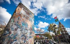 A piece of the Berlin Wall sits in front of the Porte de Versailles exhibition center in Paris, France, on Oct. 13, 2014.