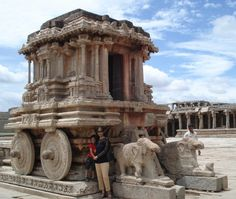 "Hampi Stone Chariot, Hampi (Karnataka) Visiting Bellary has been one of the most memorable trips i had in my life... As contrary to the fact that most of the monuments/visiting places have less greenery, the natural beauty of the stone architecture simply took my breath away. I was destines to witness liveliness of those lines which read ""If Dreams Were Made Of Stones, It Was Hampi"" ... Here's me n my son taking pride posing in front of famous Hampi Stone Chariot :)…"