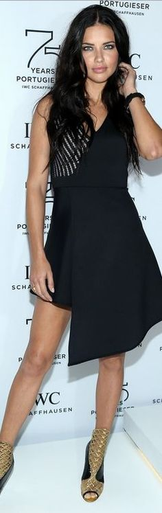 Adriana Lima: Dress – David Koma  Watch – IWC