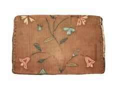 """A bifold wallet comprised of a brown silk with thin wale ribbing.  Decorated with silk satin and chain stitched embroidery of various floral motifs. The cross-stitched initials """"A I"""" are visible when flap is lifted. The flap is lined in glazed pink cotton and green cotton twill binding has been attached to all the edges. The wallet is handstitched together with green and brown thread."""