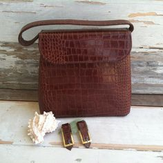 Check out this item in my Etsy shop https://www.etsy.com/listing/183508843/vintage-brown-faux-alligator-skin
