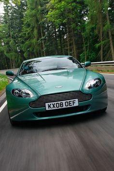 Aston Martin DB9. A new generation of the David Brown (DB) series. Green!
