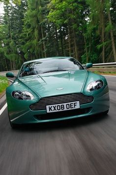 Aston Martin DB9. A new generation of the David Brown (DB) series. Green!