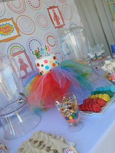 Rainbow Yo Gabba Gabba Birthday Party...Love the tulle cake stand! There are so many things you could do with this idea! You could have a ballet birthday party with cake and all...