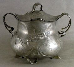 ORIVIT pewter covered vessel, decorated with ears of corn, 27cm high.