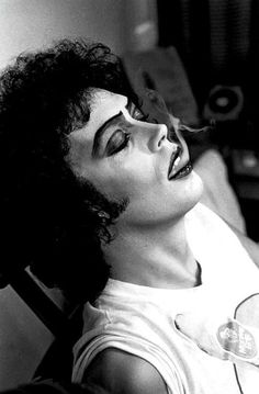 Tim Curry smoking on the set of Rocky Horror Picture Show
