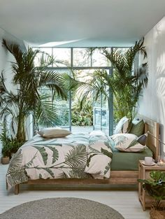 These coastal bedrooms are all about the palms. Lush palm leaf and palm frond patterns that transport you to a dreamy island paradise. Featured on Completely Coastal.
