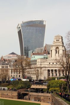 The Walkie-Talkie building, formally 20 Fenchurch Street, 2014  No. 10, Trinity Square, formerly the headquarters of the Port of London Authority, 1922  Tower of London (whose stone walls are at the bottom of this image), first built in 1078, with additions all the way to 1399.