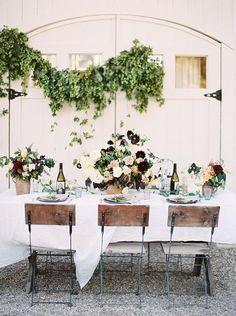 bistro chairs and outdoor wedding table setting - photo by Kara Miller http://ruffledblog.com/organic-romantic-wedding-inspiration