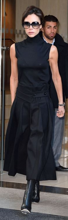 Victoria Beckham: Sunglasses – Cutler and Gross  Skirt, shoes and shirt – Victoria Beckham