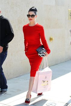 Gorgeous red knit dress and love the zebra accessories. Overall style excellent.
