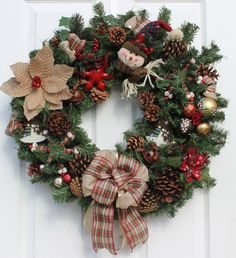 Very full , handmade, rustic snowman wreath made on a Canadian pine base and decorated with lots of extras including 20 clear LED battery operated lights, pine cones, rustic sleigh bells, plush snowman, tin and plaid snowflake ornaments and more. It is measured to fit on a standard door or ready to be displayed anywhere in your home.  I would advise indoor or sheltered outdoor use. If you do display this wreath outside, I suggest hanging the wreath under a covered porch or patio to protect…