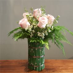 Half Dozen Roses in Rush-Covered Vase