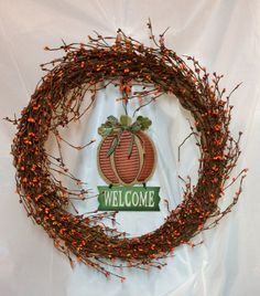 "Fall pip berry wreath with pumpkin welcome sign. Orange, gold, wine berries on 18"" vine form. 6x9"" sign in center. UV treated. Wire hanger. by KhQualityCreations on Etsy"
